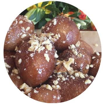 donuts, fluffy donut balls sprinkled with walnuts