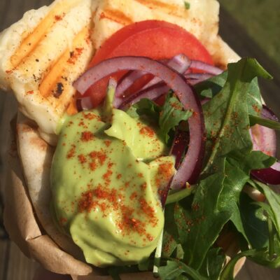 Wrap with halloumi, avocado sauce, vegetables and onions